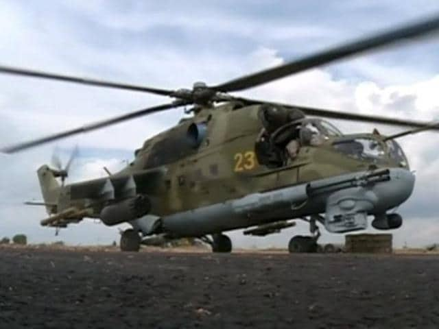 A still image from a October 6, 2015 footage shows a Russian air force helicopter on the tarmac of Heymim air base near the Syrian port town of Latakia.