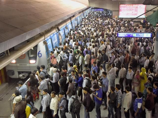 Crowd at the Rajiv Chowk metro station during the rush hours in New Delhi, India, on Monday.