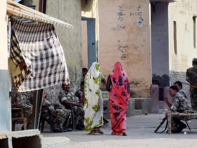 Security personnel deployed at Bisada village where Mohammad Ikhlaq was lynched by a mob after rumours that he ate beef.