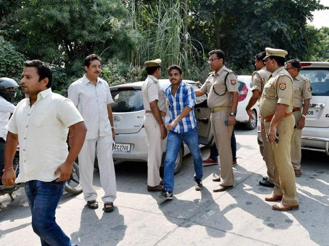Police arrest Hindu Yuva Vahini activists for shouting slogans at the entrance of Bisada village.(PTI Photo)