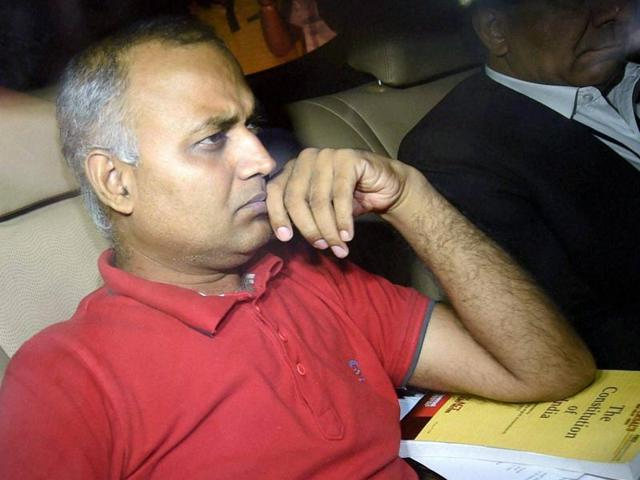AAP MLA Somnath Bharti with his lawyer arrives to surrender at the Dwarka North Police Station in New Delhi on Monday.