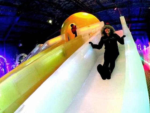 A visitor enjoying herself at the Harbin Ice Wonderland.