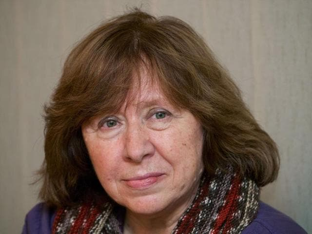 Picture taken on November 14, 2014 shows Belarus writer Svetlana Alexievich poses as she visits a Ukrainian embasy in Minsk. Svetlana is among the bookies' favourites for this year's Nobel Prize in Literature.