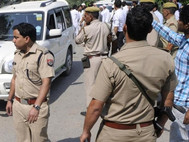 A police team patrols outside the house of Mohmmad Ikhlaq who was killed by a mob over an allegation of cow slaughtering late night on September 28, at Bisada village, in Greater Noida.