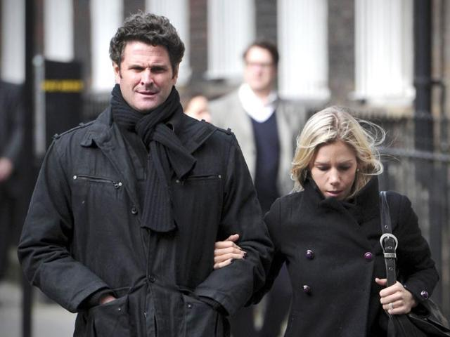 In this March 5, 2012 photo, former New Zealand cricketer Chris Cairns  and wife Melanie Croser are seen outside the high court in central London.