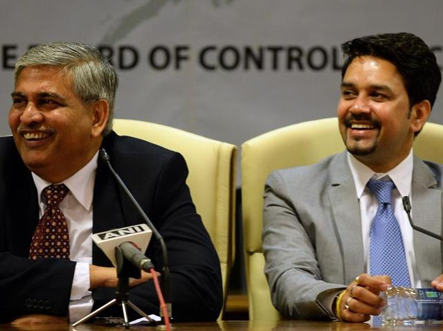 BCCI treasurer Anirudh Chaudhry, right, and secretary Anurag Thakur, centre, look on as new president Shashank Manohar speaks after taking charge at the Indian cricket board's headquarters at the Wankhede stadium in Mumbai, on October 4, 2015.