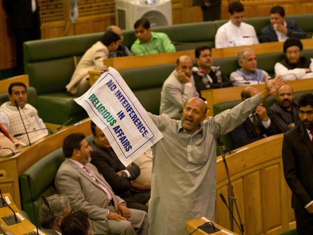 Engineer Rashid, an Independent MLA, holds a banner as he disrupts the first day of the Jammu and Kashmir assembly session in Srinagar last Saturday.