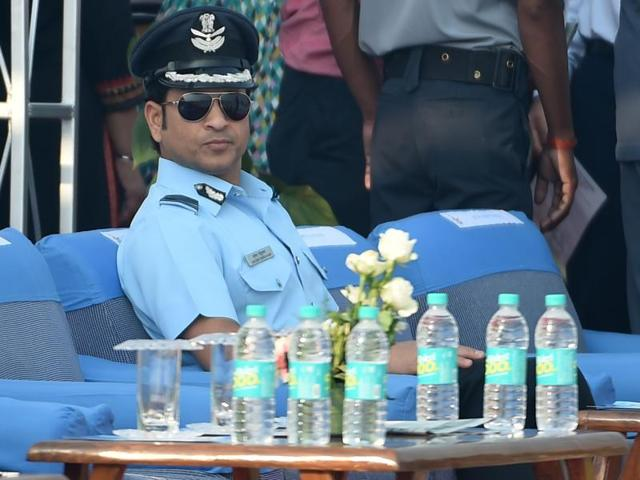 Former Indian cricketer and honorary Indian Air Force (IAF) officer Sachin Tendulkar, seated, attends the Air Force Day parade at Hindon Air Force base near New Delhi, on October 8, 2015.
