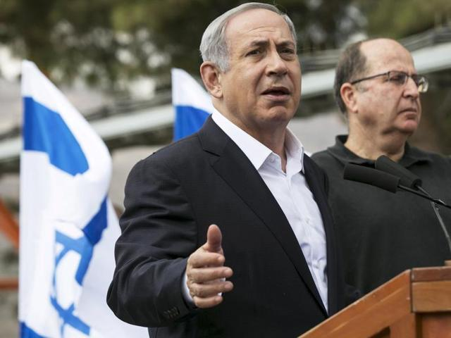 Israeli Prime Minister Benjamin Netanyahu (L) speaks to the media after attending a meeting in an army base near the West Bank city of Nablus. Palestinian President Mahmoud Abbas said on Tuesday he did not want a spike in deadly violence in east Jerusalem and the Israeli-occupied West Bank to spiral into armed confrontation with Israel.