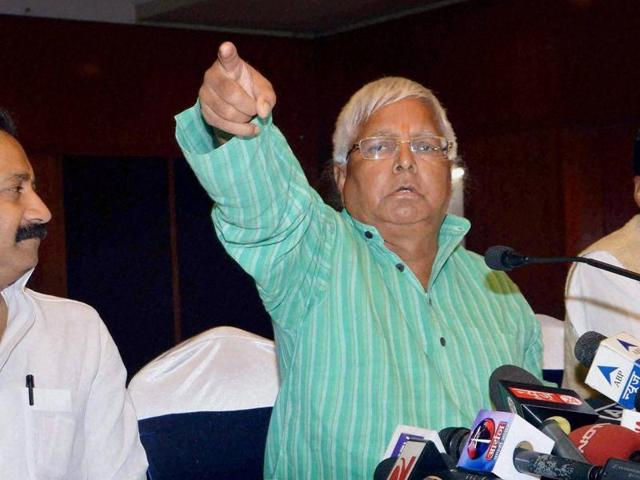 RJD chief Lalu Prasad (Centre)  with Bihar Congress President Ashok Chaudhary and JD(U) MP Pawan Verma addressing a press conference in Patna on Thursday.