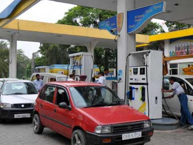 Vehicles line up at petrol pumps in Chandigarh after a slash in fuel rates.