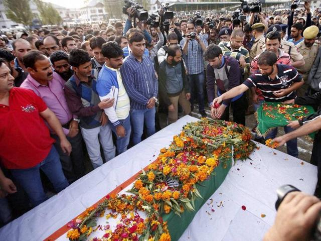 Relatives and police officers carry a coffin containing the body of police officer Altaf Ahmad during a wreath-laying ceremony at the police control room in Srinagar. Ahmad was injured after unidentified militants opened fire on his vehicle in north Kashmir's Bandipora district, and later succumbed to his injures in an army hospital.