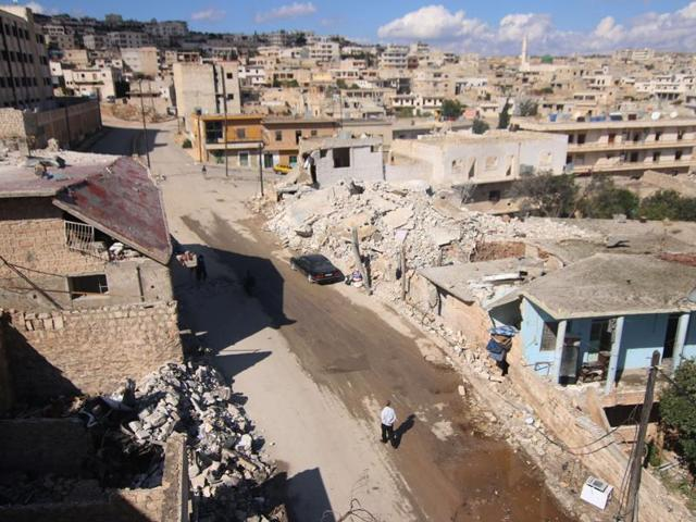 A general view shows damaged buildings in Darat Azzah, west of the northern Syrian city of Aleppo. Syrian regime forces, supported by heavy Russian aerial bombing and cruise missile strikes from warships, launched a major ground offensive against rebels in a coordinated attack in Hama province.
