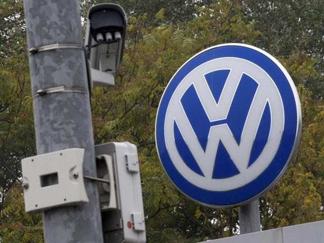 A Volkswagen logo stands next to a CCTV security camera in Wolfsburg, Germany. Volkswagen chief executive Matthias Mueller said, in an interview with a German newspaper, that the company would launch a recall for cars affected by its diesel emissions crisis in January and complete the fix by the end of next year.