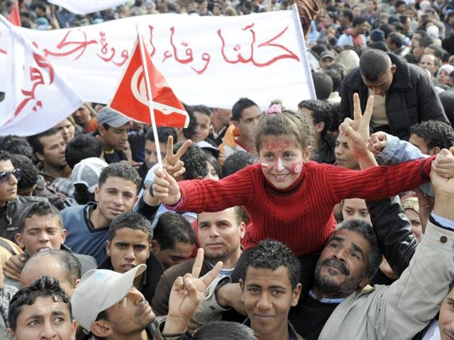 A photo taken on December 17, 2011 shows people gathering at the Sidi Bouzid's Mohamed Bouazizi square, named after the fruitseller whose self-immolation sparked the revolution that ousted a dictator and ignited the Arab Spring. Tunisian mediators of the so-called National Dialogue Quartet won the 2015 Nobel Peace Prize.