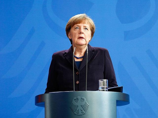 German Chancellor Angela Merkel reacts as she makes a statement in Berlin.