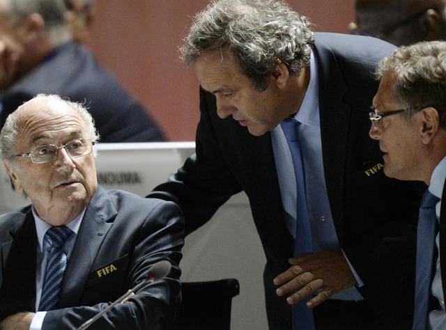 Issa Hayatou, left, the president of the Confederation of African Football (CAF), will take over as acting Fifa president following Sepp Blatter's 90-day suspension.