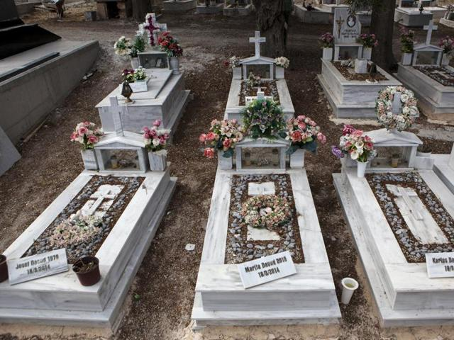 The graves of a Syrian Christian Orthodox family who drowned at sea during an attempt to cross a part of the Aegean Sea from the Turkish coast, are seen at the Saint Panteleimon cemetery of Mytilene, on the Greek island of Lesbos.