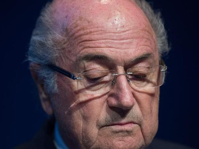 A file picture shows Fifa president Sepp Blatter looking down during a press conference, at the headquarters of the world's football governing body, in Zurich.