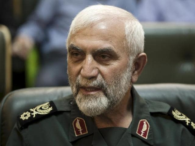 Iranian Revolutionary Guard Gen. Hossein Hamedani sits in a meeting in Tehran, Iran. Hamedani, a senior commander in Iran's powerful Revolutionary Guard was killed by Islamic State extremists on the outskirts of the northern Syrian city of Aleppo.