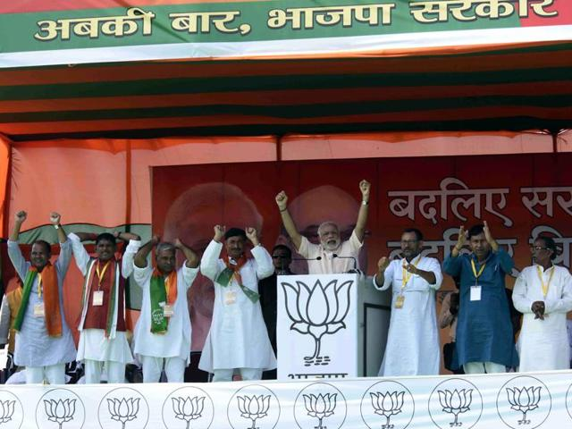 Narendra Modi addresses supporters during an election rally in the Begusrai district of Bihar on October 8, 2015.