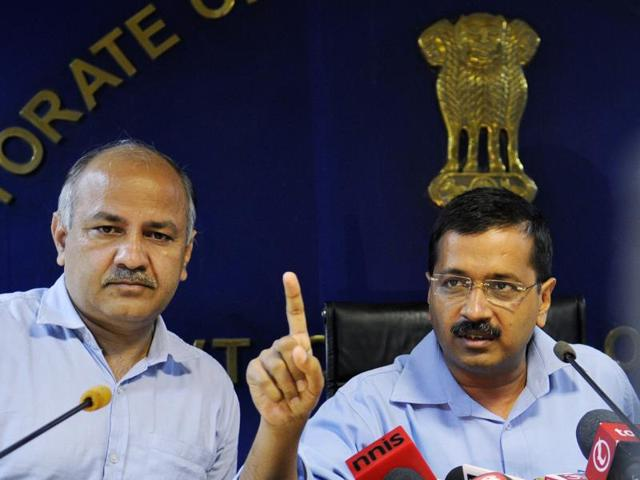 Delhi Chief Minister Arvind Kejriwal along with deputy CM Manish Sisodia announcing that he has sacked minister of food and Civil supply, environment and forest, minority affairs and elections, Asim Ahmed Khan, on corruption charges, at Delhi Secretariat, in New Delhi, India, on Friday, October 9, 2015.