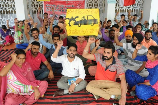 Members of Punjabi University Students Sangersh Committee holding a protest against management in Patiala.