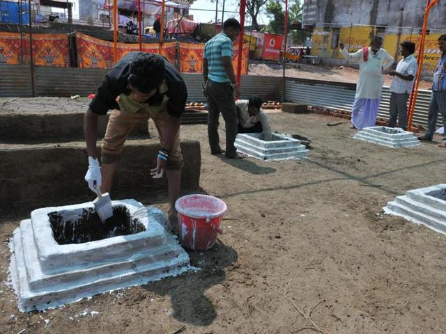 People prepare havan kunds for performing rituals for peace to the souls of blast victims, in Petlawad on Friday.