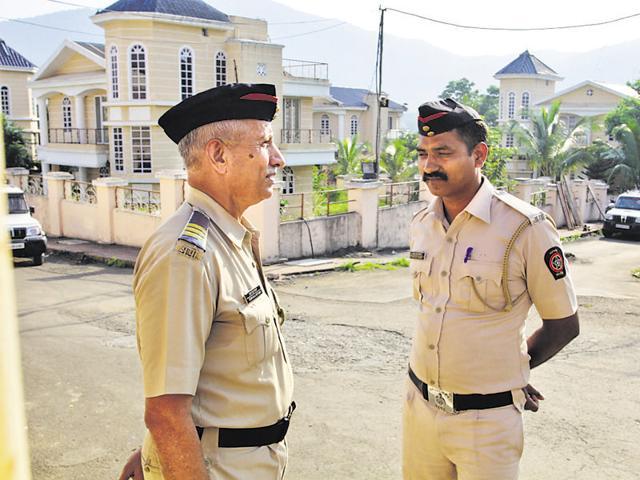 Policemen outside Thane builder Suraj Parmar's bungalow at Ovala village, Thane, on Thursday.