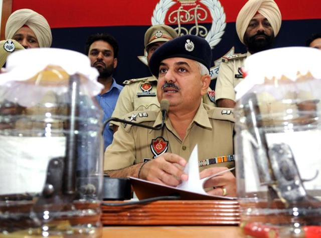 SSP Gurmeet Singh Chauhan addressing a press conference at the police lines in Patiala on Thursday.