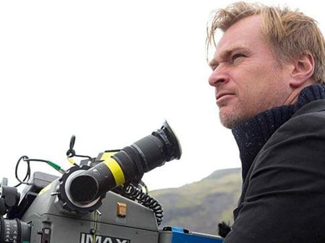 Directot Christopher Nolan with his weapon of choice.