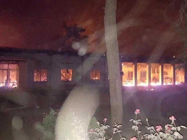 In this Saturday, October 3, 2015 file photo, the Doctors Without Borders hospital is in flames in Kunduz, Afghanistan, after being hit by a US airstrike.