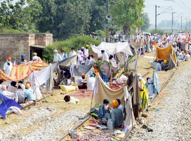 Farmers blocking railway traffic at Muchhal village, 28 km from Amritsar, on Friday.
