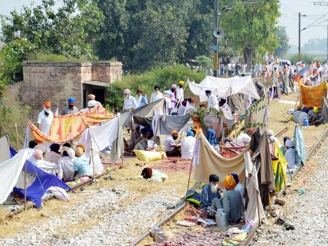 Farmers blocking railway traffic at Muchhal village, 28 km from Amritsar.