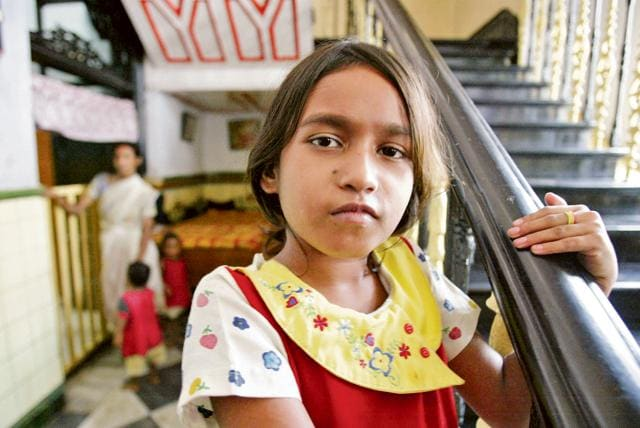 Arpita, 9, looks on from inside the Shishu Bhavan, a home run by the Missionaries of Charity in Kolkata.