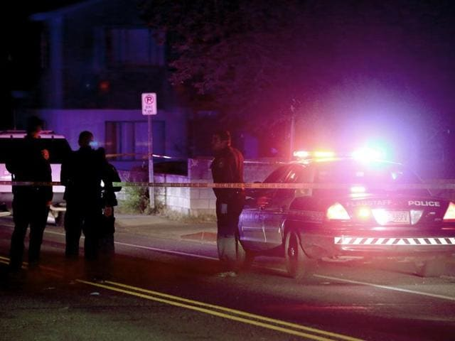 Police officers gather at the site of a shooting early on Friday, just outside the Northern Arizona University campus in Flagstaff, Ariz. The shooting occurred outside a dormitory near the Northern Arizona University campus.