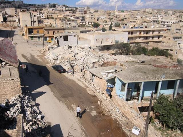 A general view shows damaged buildings in the town of Darat Azzah, west of the northern Syrian city of Aleppo, following reported bombings by government forces on. Earlier, Syrian regime forces, supported by heavy Russian aerial bombing and cruise missile strikes from warships, launched a major ground offensive against rebels in a coordinated attack in Hama province.