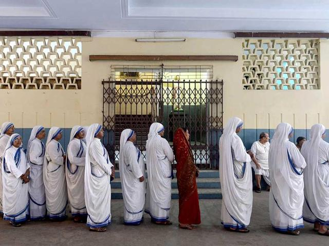 Arpita, 9, looks on from inside the Shishu Bhavan, a home run by the Missionaries of Charity, in Kolkata.