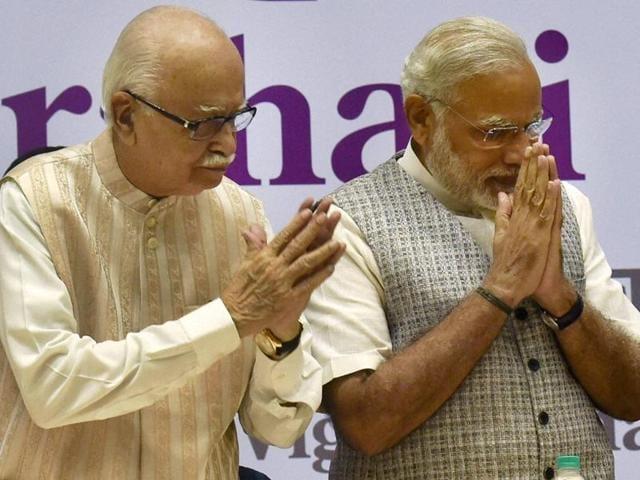 Prime Minister Narendra Modi with senior BJP leader LK Advani during the 'Loktantra Prahari Abhinandan' event on the occasion of the 113th birth anniversary of the socialist leader Jayaprakash Narayan, in New Delhi.