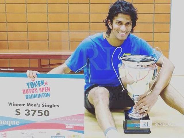 Indian shuttler Ajay Jayaram  posing with the trophy after winning the Dutch OpenGrand Prix.