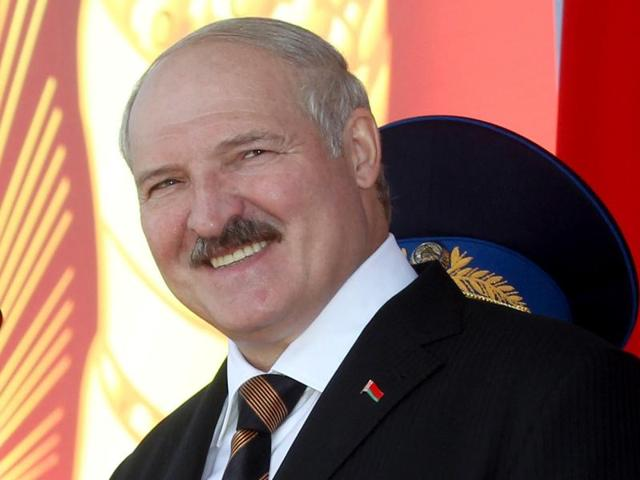 In this file photo, Belarus's President Alexander Lukashenko attends a parade marking the Independence Day in Minsk, Belarus. Alexander Lukashenko is certain to win the presidential election as his economic policies still put bread on the table while Russia's recent military forays makes his title of Europe's last dictator obsolete.