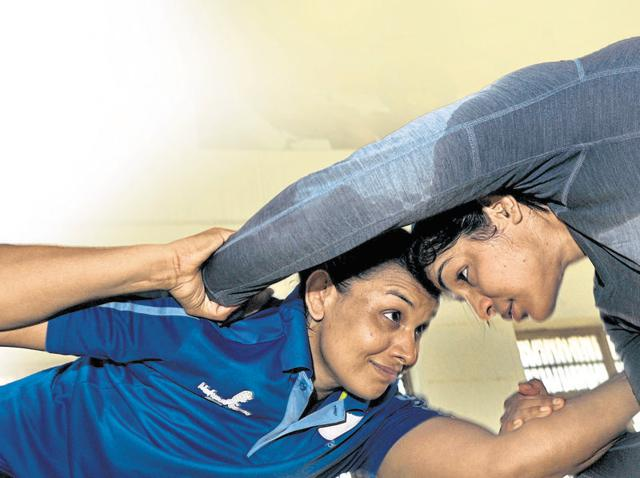 The golden girls of Rohtak have changed their lot thanks to their performances on the mat.(Ravi Kumar/HT Photo)