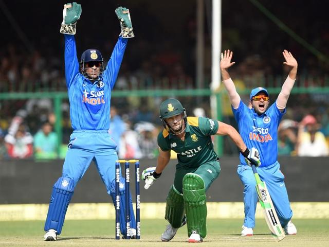 Dhoni, left, and Raina, right, make an unsuccesful appeal for LBW against South Africa