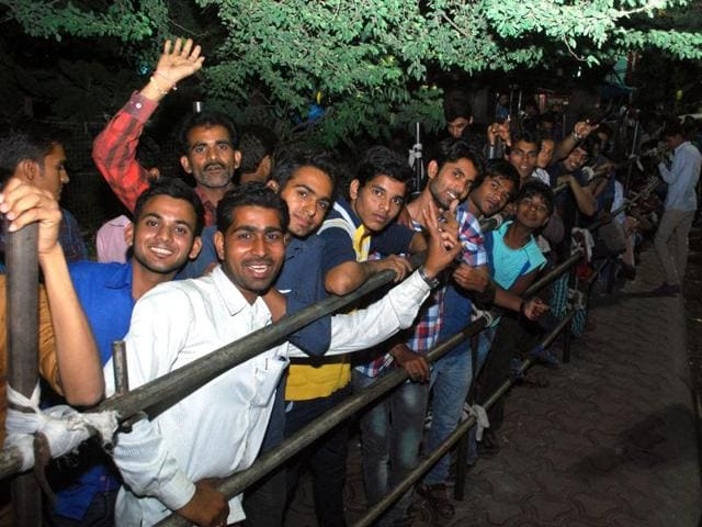 ICricket fans queue up outside the Bank of India, Yeshwant Niwas Road, on Saturday evening to purchase ODI tickets.