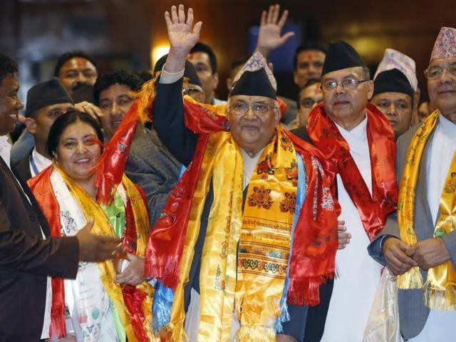 Nepal's newly elected Prime Minister Khadga Prashad Sharma Oli, also known as KP Oli (C), waves towards the media after he was elected as Nepal's 38th Prime Minister, in Kathmandu.