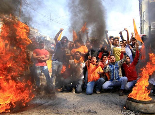 Bajrang Dal members shout slogans during a shutdown in Jammu on Saturday.