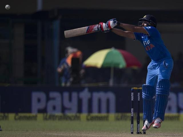 Rohit Sharma plays a shot during India's chase.