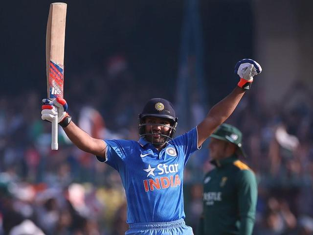 Rohit Sharma celebrates after completing his century in the first ODI against South Africa at Green Park Stadium in Kanpur, on October 11, 2015.