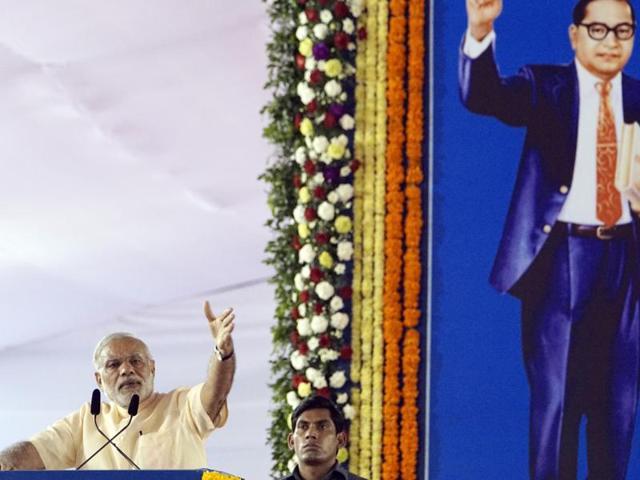 Prime Minister Narendra Modi pays respects to Babasaheb Ambedka in Mumbai on Sunday.