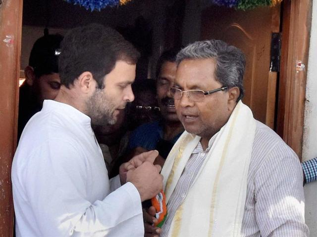 Congress Vice President Rahul Gandhi meeting with the families of farmers who committed suicide due to their crop failure, in Mandya district on Friday. Karnataka Chief Minister Siddaramaiah is also present.